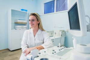 portrait-of-young-female-dentist-in-office-PT6GDWC